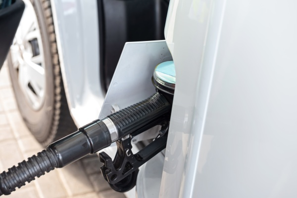 white clean car refueling on a