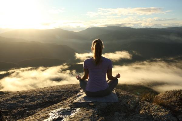 back view of a yogi doing