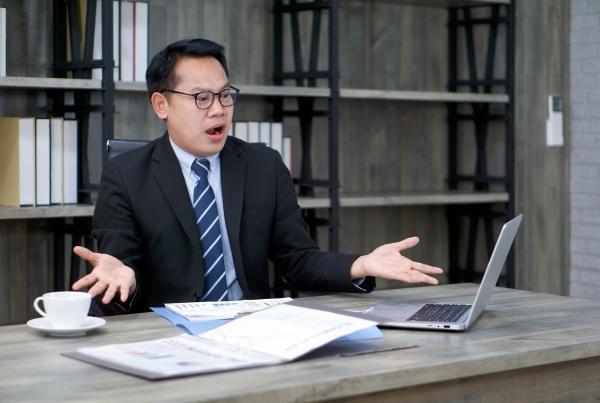 asian businessman in black suit spreads