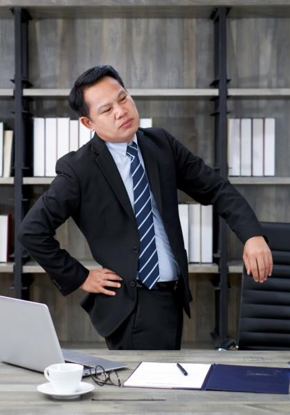 asian businessman in a suit grab