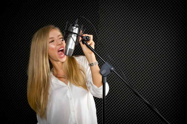 young caucasian female singing in front