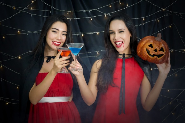 two women in red dress and