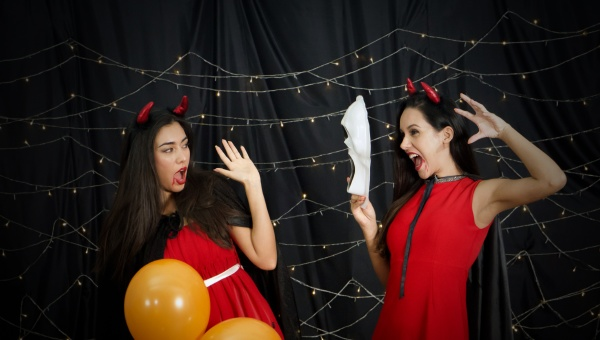two woman in red dress and