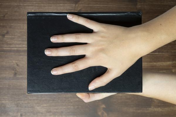 black book in her hands