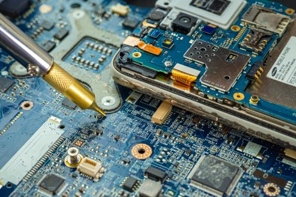 technician repairing inside of hard disk