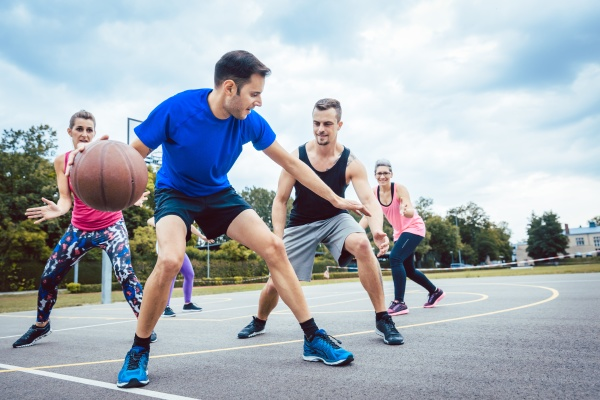 group of friends are playing basketball