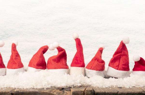 hats of santa in a row
