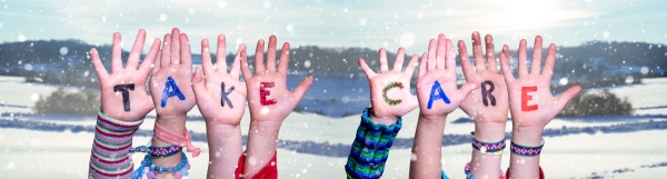 children hands building word take care