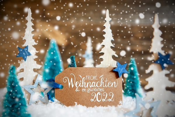 trees snowflakes wooden background glueckliches 2022