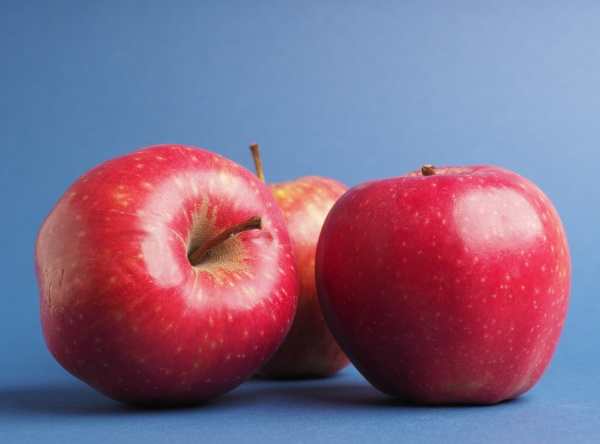 three fresh red organic apples on