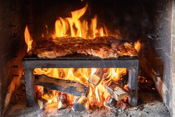 pork steaks preparing on the on