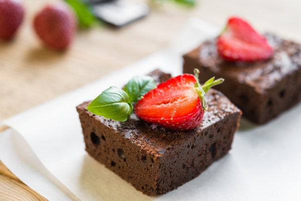 chocolate brownie cake decorated with strawberries