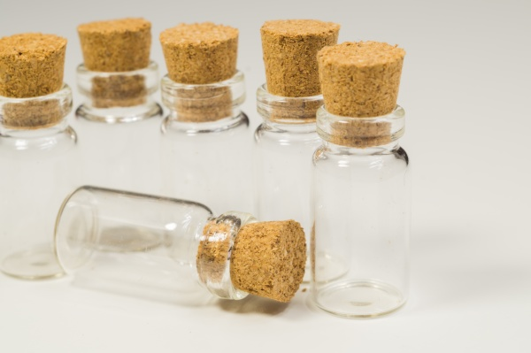 empty little bottles with cork stopper