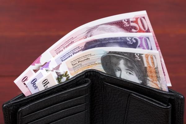 scottish money in the black wallet