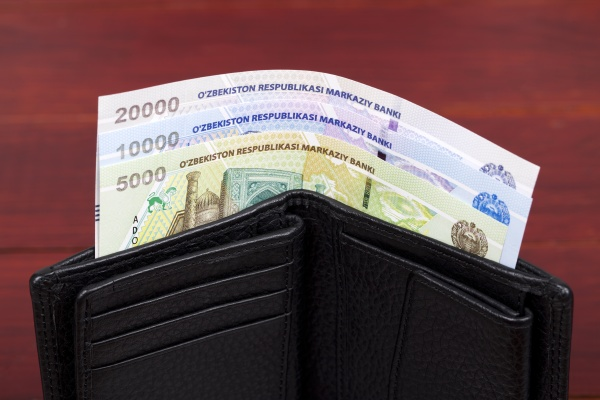uzbekistani money in the black wallet