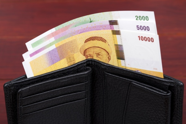 comorian franc in black wallet