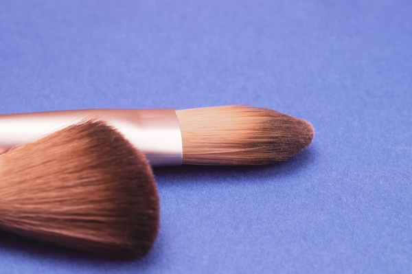 makeup brushes on blue background various