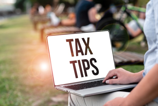 handwriting text tax tips business overview