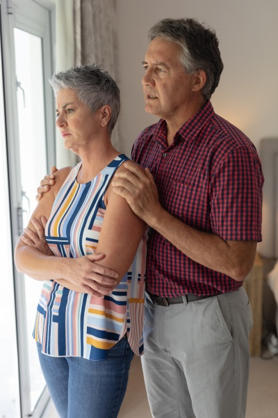 concerned senior caucasian couple standing looking