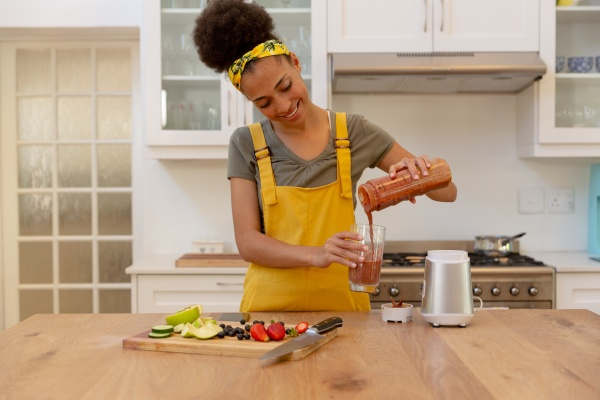mixed race woman pouring a healthy