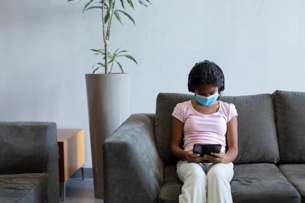 mixed race girl wearing face mask