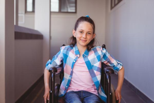 portrait of smiling disabled caucasian schoolgirl