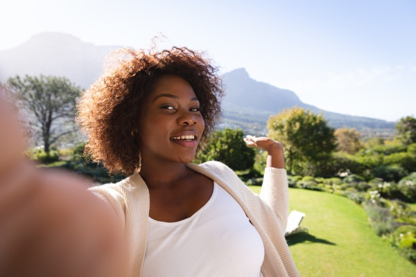 happy african american woman on sunny