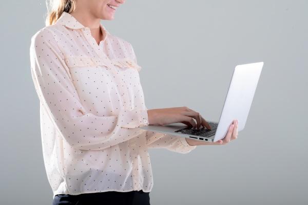 smiling caucasian businesswoman using laptop