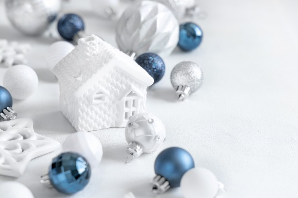 white toy house with blue