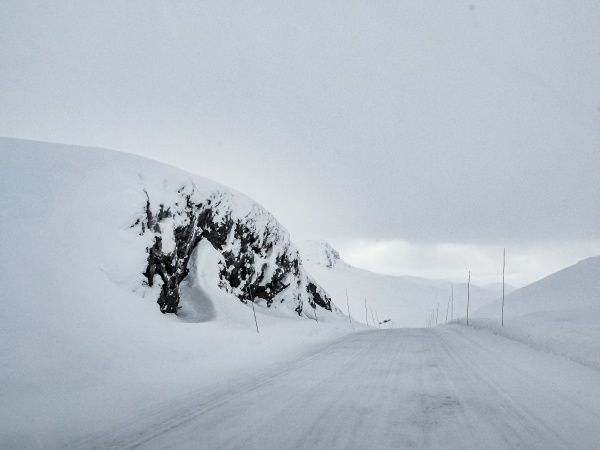 driving through snowy road and landscape