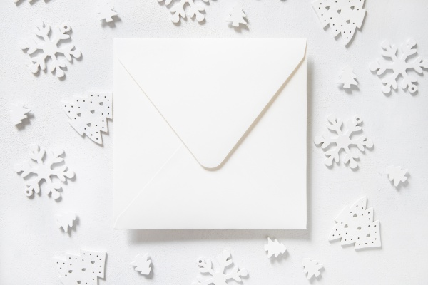 white envelope with white christmas decorations