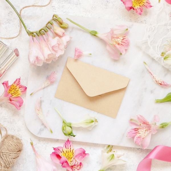 beige envelope on a white table