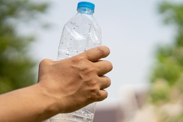 woman holding plastic bottles garbage prepare
