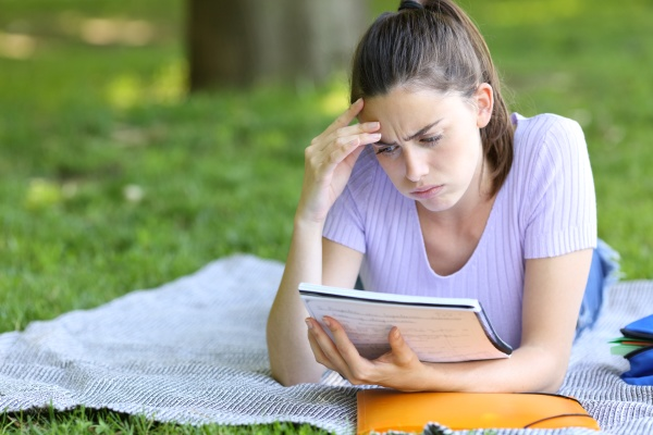 worried student studying reading notes