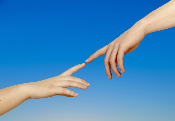 two hands on a light background