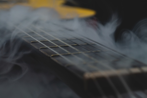 acoustic guitar in smoke close up