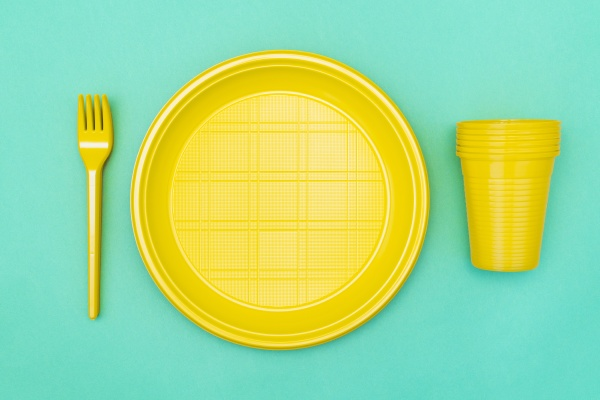 disposable plastic utensils on blue background
