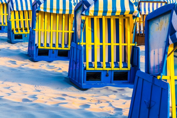 beach chairs in morning light at