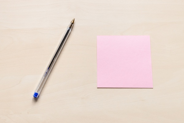 pink sheet of note paper and