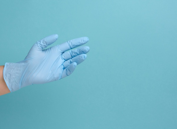 doctor s hand in a blue
