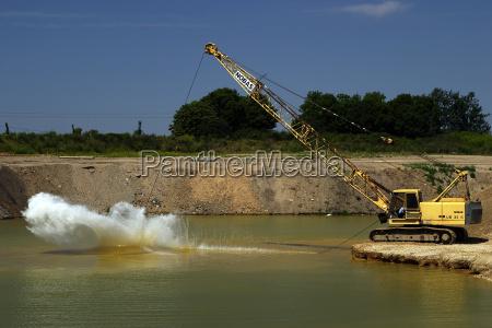 excavators at the lake