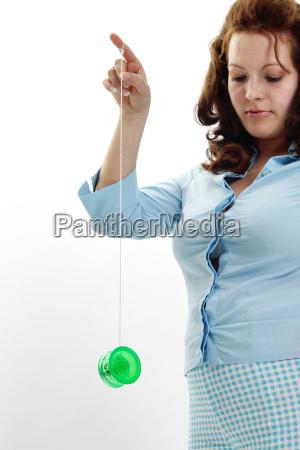 woman, playing, with, yo-yo - 299980