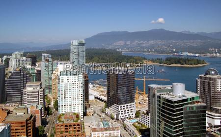 office build city town metropolis mountains