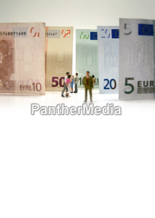 couple in front of banknotes