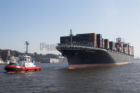 container ship in tow