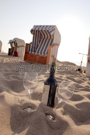 beach basket and wine bottle