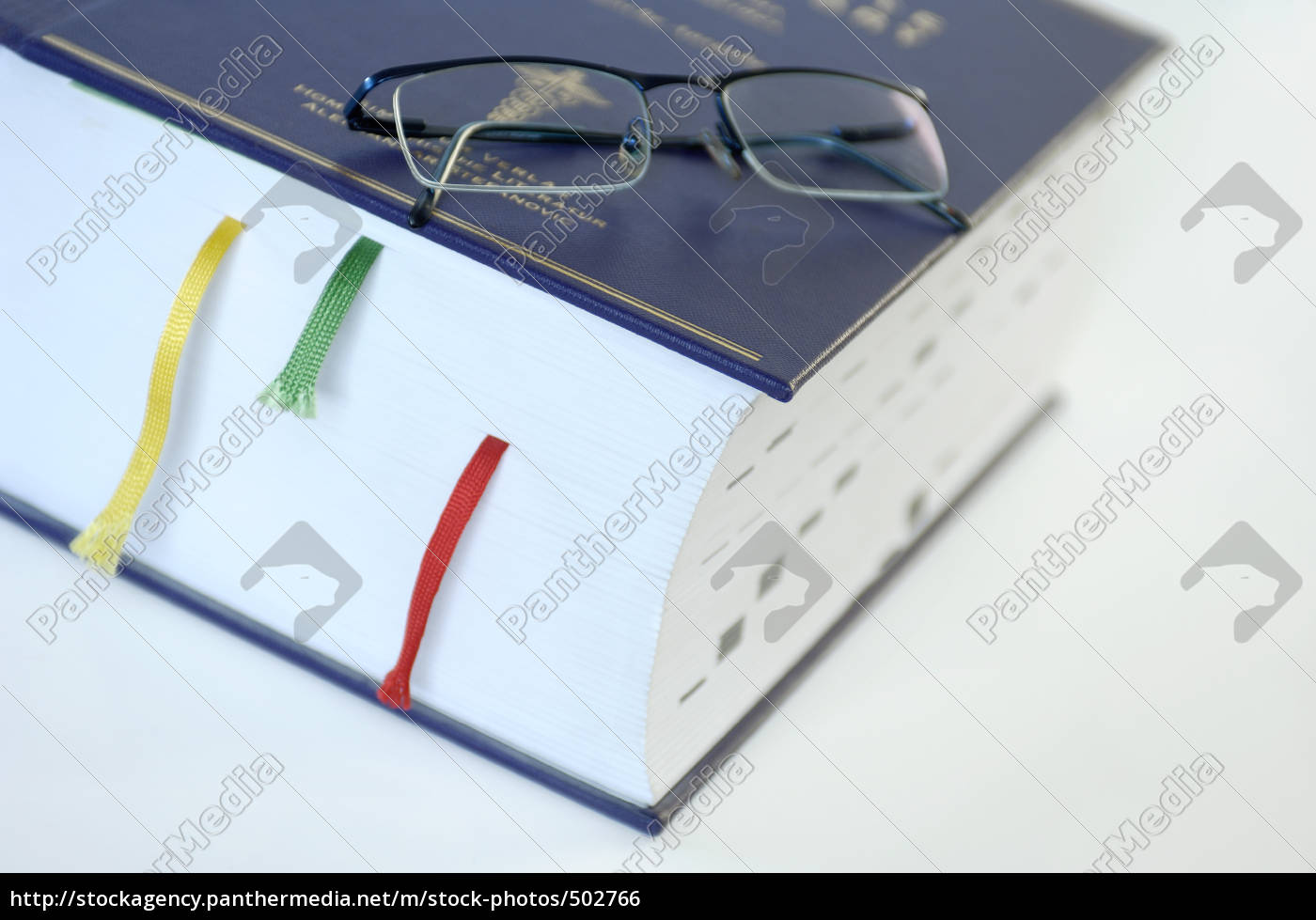 very, thick, book, with, reading, glasses - 502766