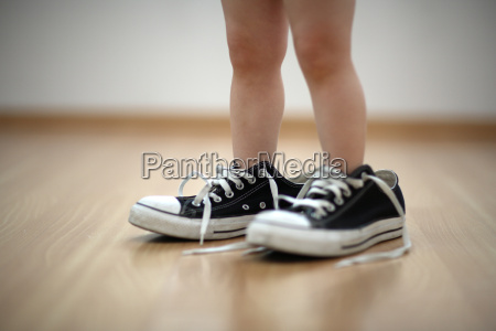 child with big shoes to
