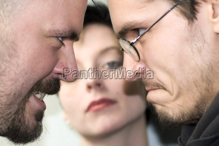 two men courting a woman