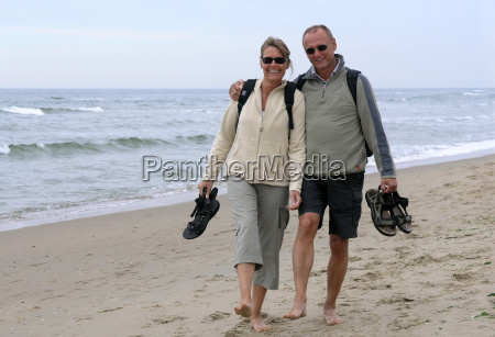 middle, aged, couple, running, on, beach - 540795
